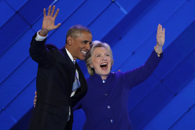 PHILADELPHIA, PA - JULY 27: US President Barack Obama and Democratic Presidential nominee Hillary Clinton wave to the crowd on the third day of the Democratic National Convention at the Wells Fargo Center, July 27, 2016 in Philadelphia, Pennsylvania. Democratic presidential candidate Hillary Clinton received the number of votes needed to secure the party's nomination. An estimated 50,000 people are expected in Philadelphia, including hundreds of protesters and members of the media. The four-day Democratic National Convention kicked off July 25. (Photo by Alex Wong/Getty Images)